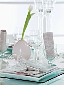 Festive table setting with a white tulip