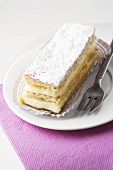 Custard slice with icing sugar