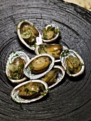 Abalone (sea snails) with herb and onion sauce