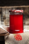 Red fruit jelly in a jar