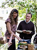 Family at buffet in garden (Sweden)