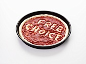 Pizza base with the words Free Choice in tomato sauce