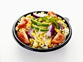 Mixed salad in a plastic container