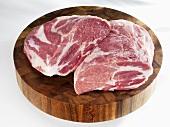 Raw pork (neck) on chopping board