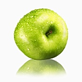 Green apple with drops of water and reflection