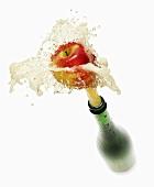 Cider splashing out of bottle