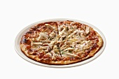 Pizza topped with chicken, mushrooms and red onions