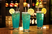 Blue Crush cocktails with rum on bar