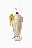 Banana shake with cream and cherry