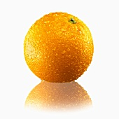 A whole orange with drops of water