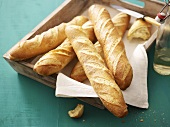 Several baguettes on wooden tray