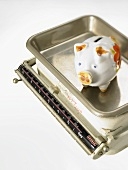 Piggy bank on kitchen scales