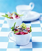 Green salad with herring and a lemon dressing