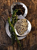 Green, black and white peppercorns (seen from above)