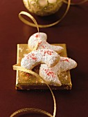 Walnut kipferl (crescent-shaped biscuits) with icing sugar on a golden square