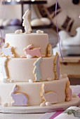 A three-tier Easter cake decorated with pastel-coloured rabbits