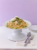 Linguine with asparagus carbonara on plate
