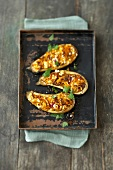 Eggplant with carrot and lentil filling on baking tray