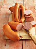 Various sausages on a chopping board