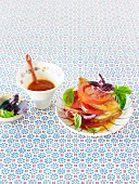 Layered tomato and bread salad with onions and basil