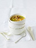 Potato and apricot soup with croutons and pine nuts