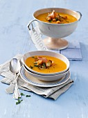 Turnip and sweet potato soup with ham and croutons