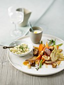 Couscous with roasted vegetables on plate