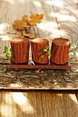 Chocolate mousse shaped like tree trunks