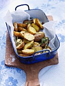 Roast potatoes with rosemary in a baking dish