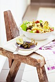Winter pasta salad with sausage, Manchego and caper fruits