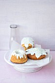 Three mini cakes decorated with icing sugar