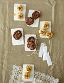 Chocolate and nut whirls and pine nut biscuits