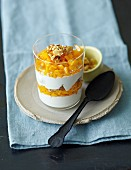 Yogurt cream with mango and walnuts
