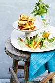 Steamed spring vegetables with a herb sauce and wild garlic pancakes