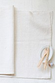 Wooden forks, wooden skewers and kitchen twine on a linen cloth