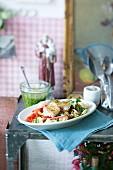 Vegetable salad with pasta, nut pesto and zander