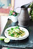 Spaghetti with a green vegetable sauce, goat's cheese and mange tout