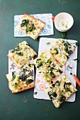 A pizza topped with fennel, spinach and Appenzeller cheese