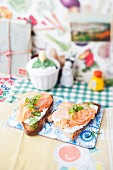Bruschetta topped with salmon, pear and rosemary