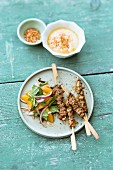 Oriental lamb skewers served with and onion and orange salad with mint