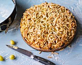 Gooseberry cake topped with slivered almonds