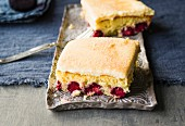 Slices of raspberry tray bake with walnuts