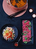 Chinese fondue, beef and a glass noodle salad