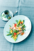 Asparagus salad with smoked trout, caviar and nasturtiums