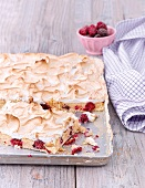 Blackberry tray bake cake topped with meringue