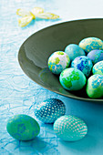 A bowl of coloured eggs