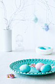 Easter eggs on a turquoise plate