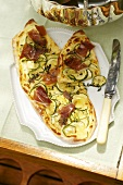 Tarte flambée with Parma ham and courgettes