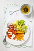 Salmon salad with egg, celery and oranges