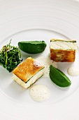 Sturgeon wrapped in white bread with spinach
